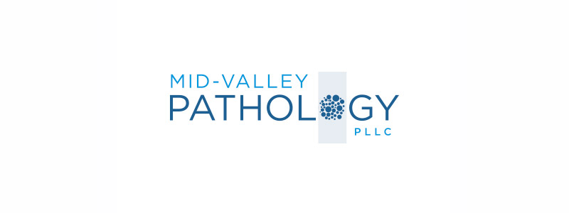 medical logo layout with a microscopic lense slide as well as germs made for Urbandale medical center.
