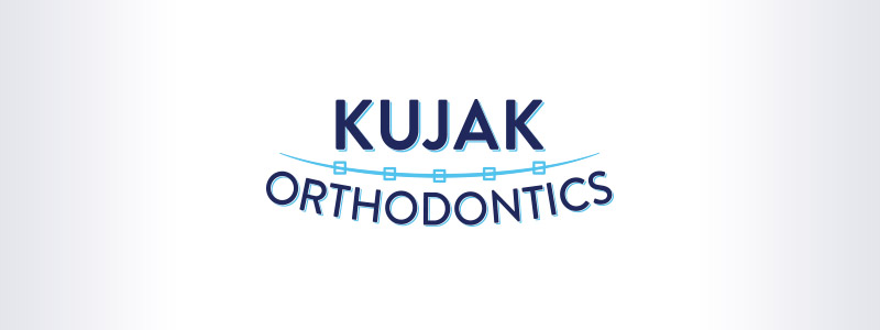Logo created for an orthodontist in Urbandale, style include an arc with lines converging through it to indicate metal braces.