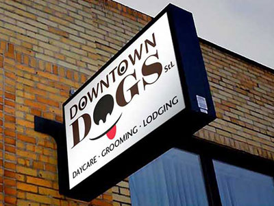 Downtown Dogs - Seattle Sign Company - Internally illuminated double faced flag mounted cabinet sign
